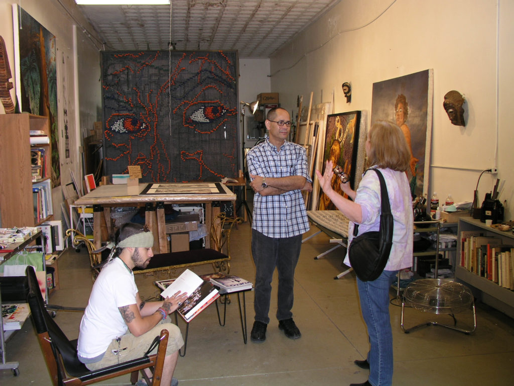 Angel_Rodriguez-Diaz_and_curator_Kellen_McIntyre_chat_in_Angels_studio